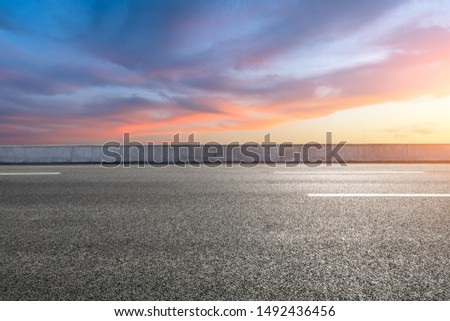 Empty asphalt highway and beautiful sky clouds at sunset #1492436456