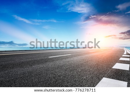 empty asphalt highway and blue sea nature landscape at sunset #776278711