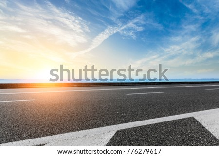 empty asphalt highway and blue sea nature landscape at sunset #776279617