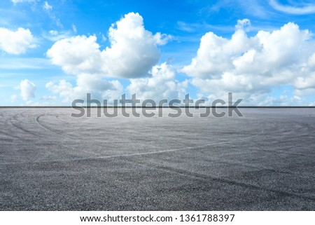 Empty asphalt race track ground and beautiful sky clouds  #1361788397