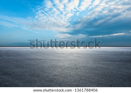 Empty asphalt race track ground and beautiful sky clouds