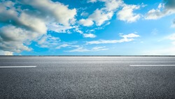 Empty asphalt road and blue sky with white clouds.Road background.