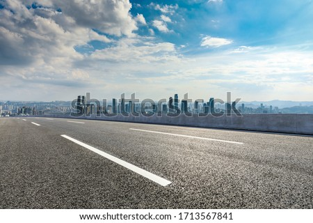 Empty asphalt road and Chongqing city skyline and buildings scenery,China.