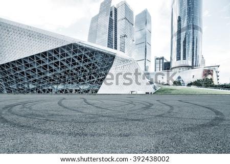empty asphalt road and modern buildings in guangzhou