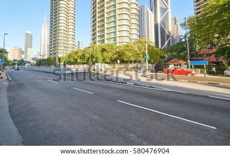 Empty asphalt road and modern buildings in Kuala Lumpur,Malaysia.