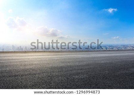 Empty asphalt road and modern city skyline with buildings in Shanghai,China
