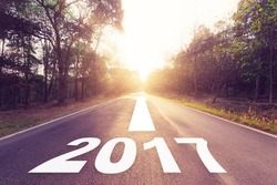 Empty asphalt road and New year 2017 concept.