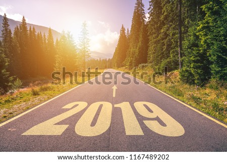 Empty asphalt road and New year 2019 concept. Driving on an empty road in the mountains to upcoming 2019 and leaving behind old 2018. Concept for success and passing time. #1167489202