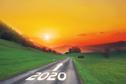 Empty asphalt road and New year 2020 concept. Driving on an empty road on goals in the mountains to upcoming 2020 and leaving behind old years. Concept for growth success, passing time and future.