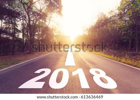 Empty asphalt road and New year 2018 goals concept. #613636469
