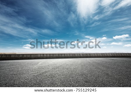 empty asphalt road and snow mountains in blue cloud sky #755129245