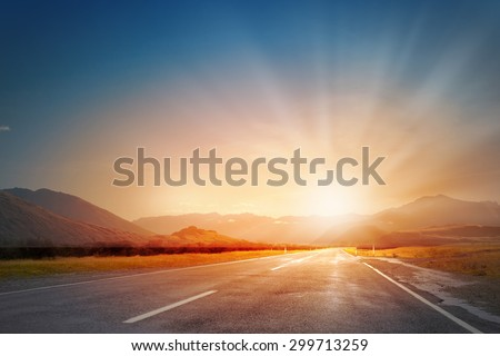 Empty asphalt road and sun rising at skyline #299713259