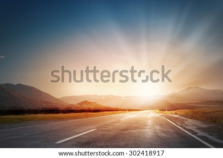 Empty asphalt road and sun rising at skyline #302418917