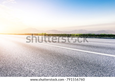 empty asphalt road front of cityscape in hangzhou,china #791556760