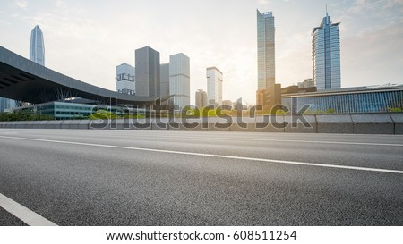 empty asphalt road of a modern city with skyscrapers