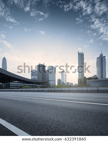 empty asphalt road of a modern city with skyscrapers #632391860