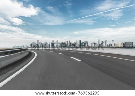 empty asphalt road with city skyline background in china.\r