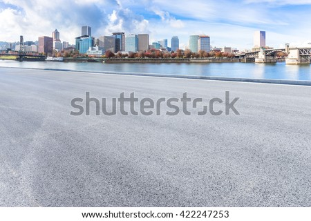 empty asphalt road with cityscape and skyline of portland #422247253