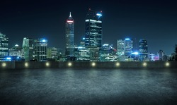 Empty asphalt roof top with modern city skyline , night scene ,Perth , Australia .