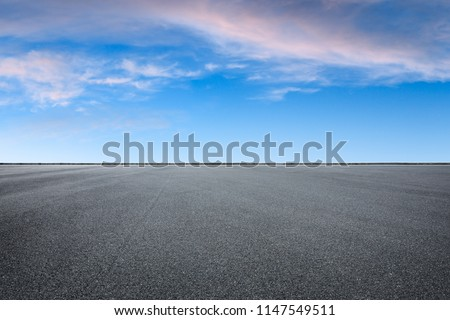 Empty asphalt square and beautiful colorful sky clouds at sunrise #1147549511