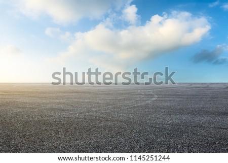Empty asphalt square landscape at sunrise #1145251244