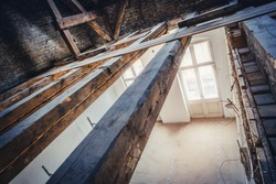 empty attic / loft during dry rot renovation, old roof beams