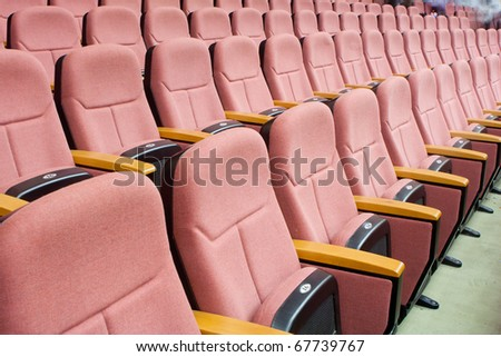 empty auditorium with red chairs, theatre or conference hall #67739767