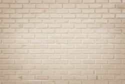 Empty Background of wide cream brick wall texture. Old brown brick wall concrete or stone pattern nature, wallpaper limestone abstract floor/Grid uneven interior rock. Home & office design backdrop.