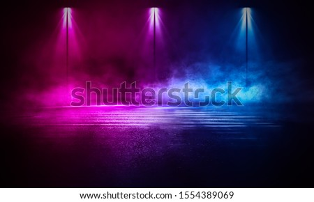 Empty background scene. Dark street reflection on the wet pavement. Rays neon light in the dark, neon figures, smoke. Night view of the street, the city. Abstract dark background. Abstract spotlight.