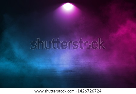 Empty background scene. Dark street reflection on wet asphalt. Rays of neon light in the dark, neon figures, smoke. Background of empty stage show. Abstract dark background.