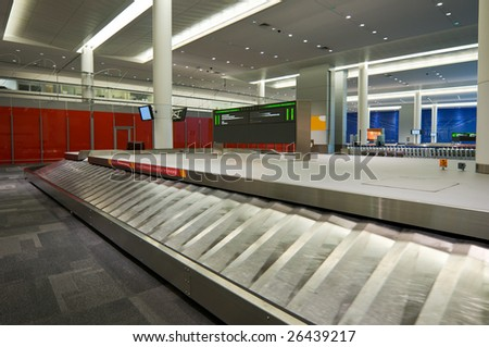 Empty baggage claim area at airport, waiting for luggage to arrive