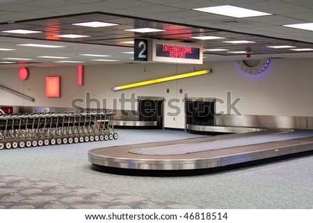 Empty baggage claim carousel.  International Airport.  Baggage cars.  Waiting for the plane to land and unload.