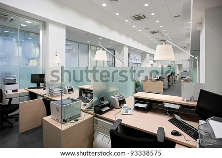 Empty bank office with desks in raw - stock photo