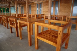 empty bar with geometrical wooden chairs, at Ponta Do Sol, Madeira