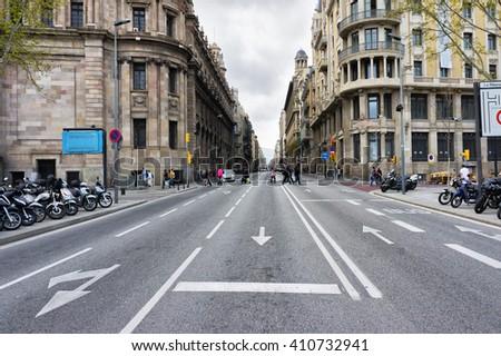 Empty Barcelona street, Catalunya, Spain. Barcelona city road. Empty Barcelona road. Barcelona road view. Barcelona old town road. Barcelona architecture near big empty road. Empty city road.