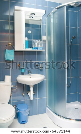 Empty bathroom in hotel with glass shower