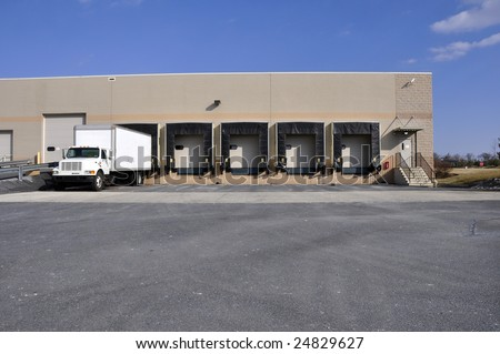 empty bays and truck at a warehouse unloading dock