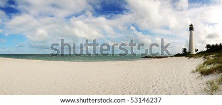 Empty beach and light house in tropical environment