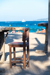 Empty beach cafe with view on blue water of Gulf of Saint-Tropez, French Riviera, France in summer