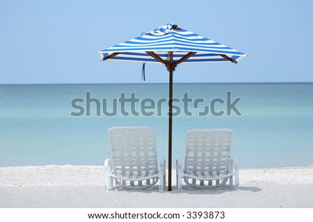empty beach chairs overlook the Gulf of Mexico from Florida's beach