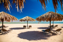 Empty beach with sunbeds and umbrellas, Egypt. Vacation concept.