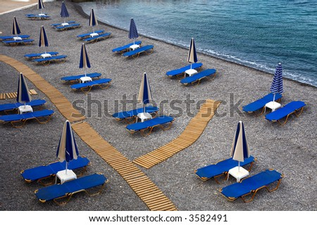 Empty beach with the closed umbrellas