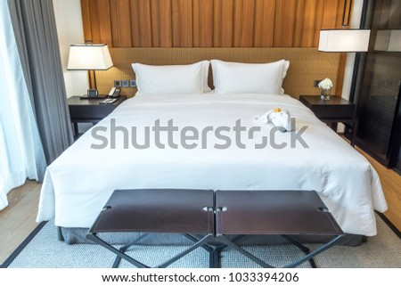 Empty bed in bedroom, rest, interior, comfort and bedding concept - bed at home bedroom #1033394206