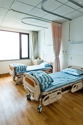 Empty bed in hospital ward.