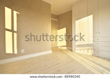 Empty bedroom inside a modern house - stock photo