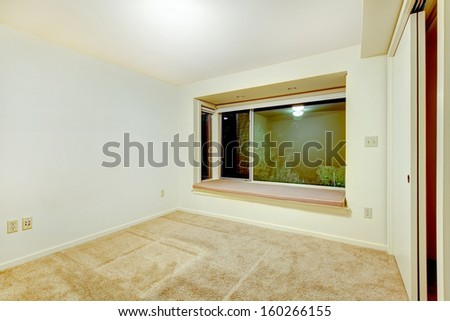 Empty bedrooms interiors with beige carpet. Guest house of luxury real estate. Night window view.