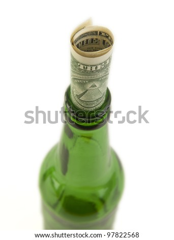 Empty beer bottle and money. Isolated on white background  concept of alcoholism spending money hoarding and tip