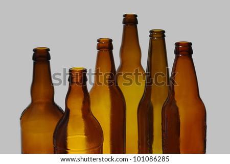 Empty beer bottles on gray