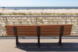 Empty Bench along the Long Beach New York Boardwalk facing towards the Beach and Atlantic Ocean