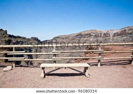 Empty bench in front of volcano Vesuvius crater. This bench is used during trekking